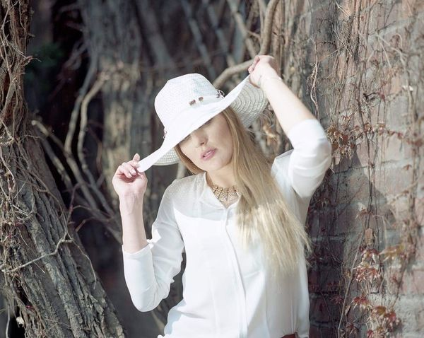 White Hat Pentax 67II + Pentax 67II 165mm f/2.8@4.0 + Kodak Porta 160 Young Adult Long Hair One Woman Only Blond Hair Beauty One Person Fashion People Outdoors Portrait The Portraitist - 2017 EyeEm Awards