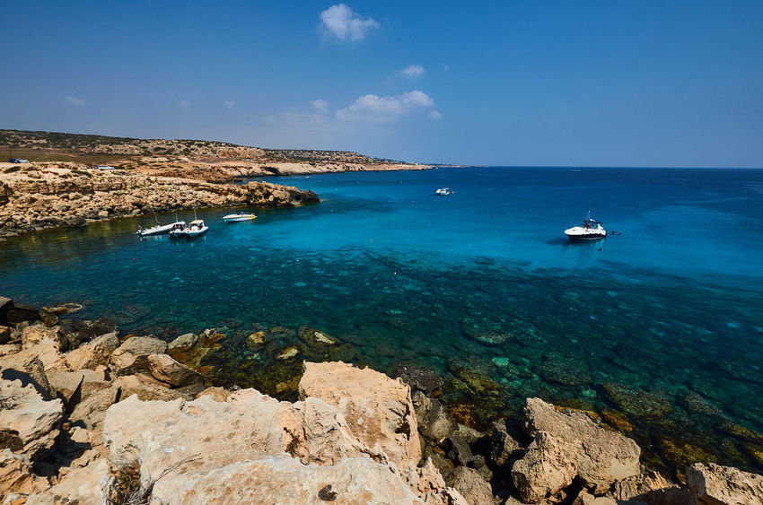 Cape Greco, Cyprus Cyprus Beauty In Nature Blue Cape Greco Cliff Day Horizon Over Water Idyllic Mode Of Transport Nature Nautical Vessel No People Outdoors Rock - Object Sailboat Sailing Scenics Sea Sky Tranquil Scene Tranquility Transportation Travel Destinations Vacations Water Yacht