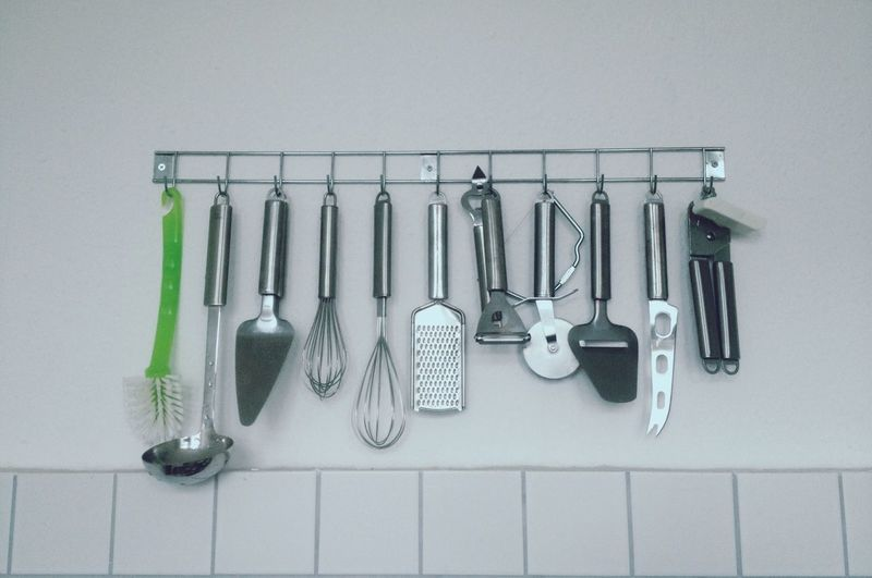 Assorted Utensils Hanging In A Kitchen