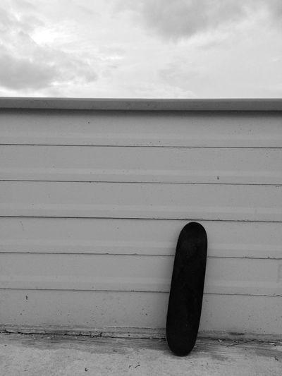 Skateboard against wall