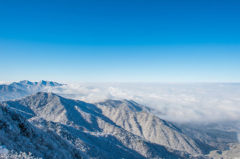 Deogyusan mountains in winter, Korea. Beauty In Nature Blue Cold Temperature Day Fog Landscape Mountain Mountain Range Nature No People Outdoors Scenics Sky Snow Tranquil Scene Tranquility Weather Wilderness Area Winter
