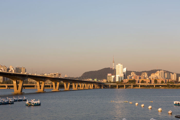 View over Han river to the city of Seoul, south Korea Han River Seoul Seoul, Korea Architecture Bridge - Man Made Structure Building Exterior Built Structure City Cityscape Clear Sky Connection Day Han River Bridge Mode Of Transport Nature Nautical Vessel No People Outdoors River Sky Skyscraper Transportation Travel Destinations Water Waterfront