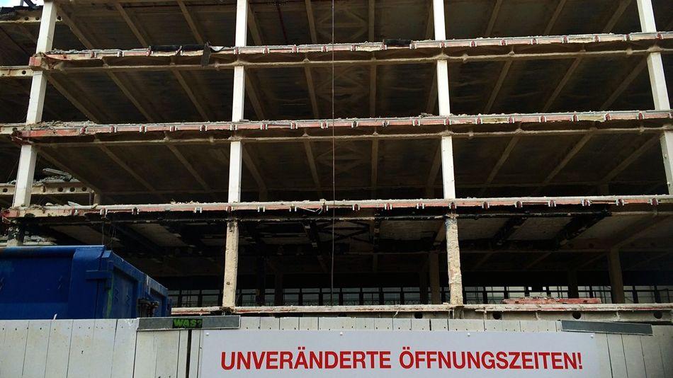 // unaltered opening hours // Streetphoto_color Grid Constructionporn Shopping Lerone-frames Ekphrasis Und Alltag Abandoned Buildings Façade Consumerism