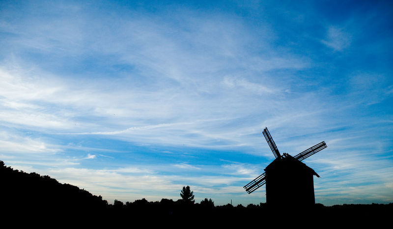 Windmill on the field and blue cloudy sky Agriculture Architecture Cloud - Sky Day Field Horizon Low Angle View Mill Nature No People Outdoors Silhouette Sky Village Windmill
