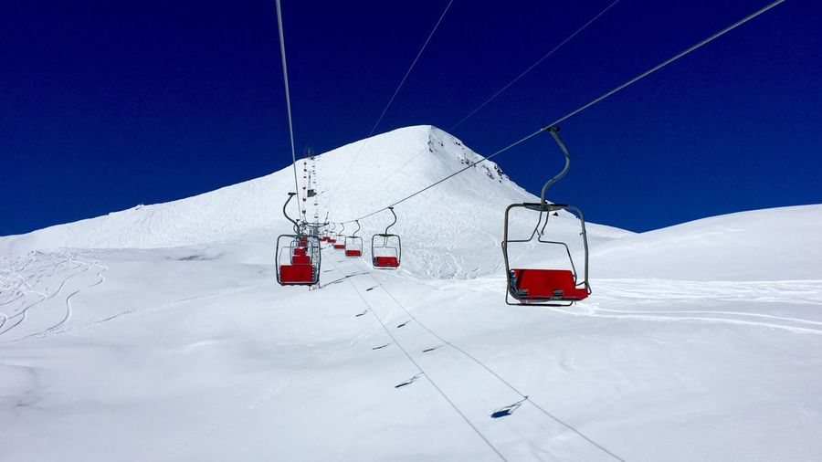 Sessellift. Cold Temperature Snow Winter Mountain White Color Ski Lift Cable Car Beauty In Nature Nature Transportation Mode Of Transportation Environment Winter Sport Scenics - Nature Landscape Cable Overhead Cable Car Travel Day Snowcapped Mountain No People Electricity  Ski Slope Ski Resort