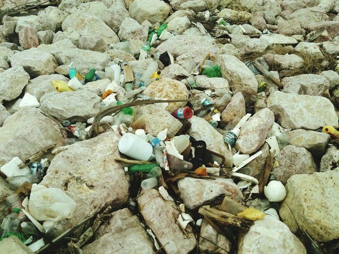 Debris On The Rocks Ocean Debris Trash Peoples Laziness Harmful Ignorance Pollution In My World Dangerous People That Dont Care People That Do Care! I have to Live on this Island, put your damn trash in a trash can not in the ocean, sand, beach, rocks or anywhere else.
