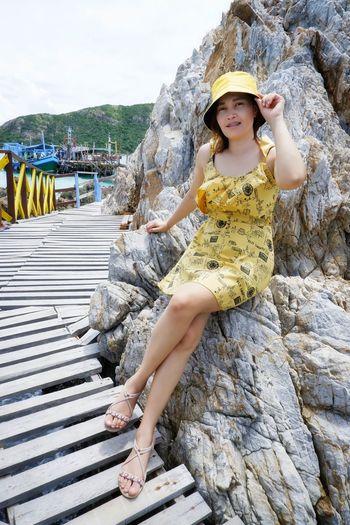 Portrait of woman standing on rock