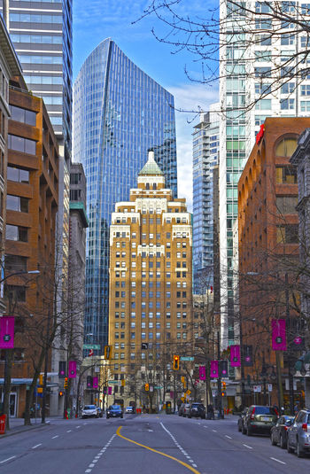 Vancouver City Architecture Bristishcolumbia Building Building Exterior Built Structure Canada Car City City Citylife Day Modern No People Outdoors Photography Road Sky Skyporn Skyscraper Street Streetphotography Tree Urban Vancouver Vancouver BC