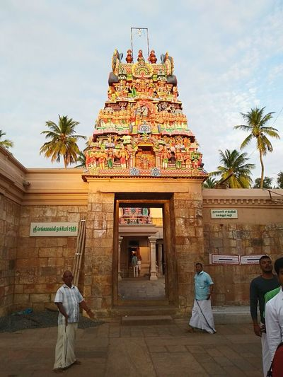 Tamilnadutourism Tamilnadu India Streetphotography Tamilian Clouds And Sky Entrance people and places Temples Of India Religious Architecture Hindhu Temple Real People Coconut Trees Stone Stone Wall Morning Sky Holy Place Vacation EyeEmNewHere Beautifuldestinations Moto G5