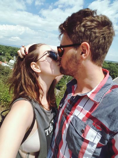 Two People Togetherness Heterosexual Couple Sunglasses Adults Only Young Adult Bonding Young Women Adult Headshot Summer Couple - Relationship People Friendship Cloud - Sky Outdoors Side View Love Casual Clothing Young Couple