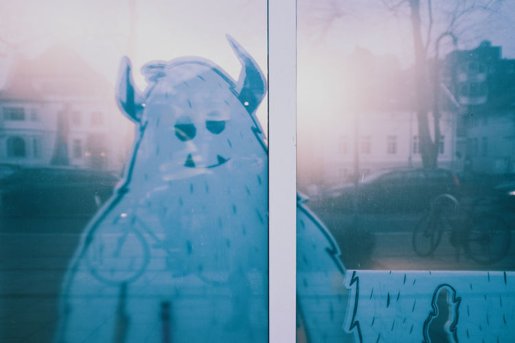 HARVEY Yeti Friend Glass - Material Window Transparent Day No People Reflection Architecture Building Exterior Winter Nature Cold Temperature Built Structure City Wet Outdoors Communication Representation Mode Of Transportation Snow Rain Glass Rainy Season Snowing