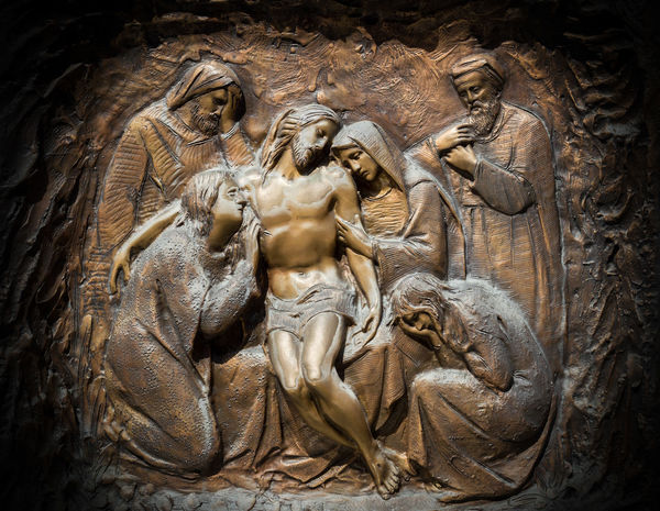Bronze wall engraving scene depicting the Lamentation of Christ Architecture Bronze Catholic Christian Christianity Church Cross Death Faith God Gothic Jesus Lament Maria Mary Mother Mourning Bas-relief Engraved Engraving Lamentation Landmark Monument Old Religious