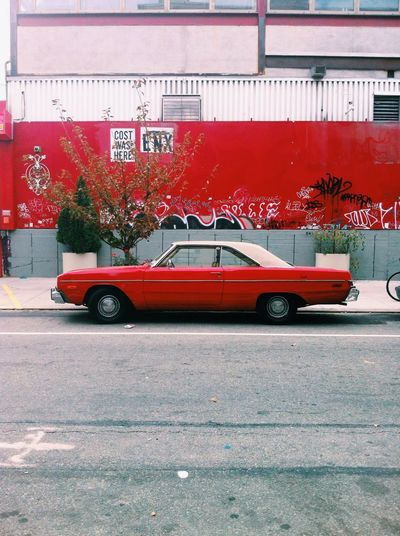 Close-up of red car on wall