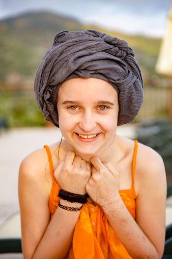 Portrait of smiling teenage girl wearing headscarf