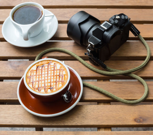 Close-up of coffee with camera on table