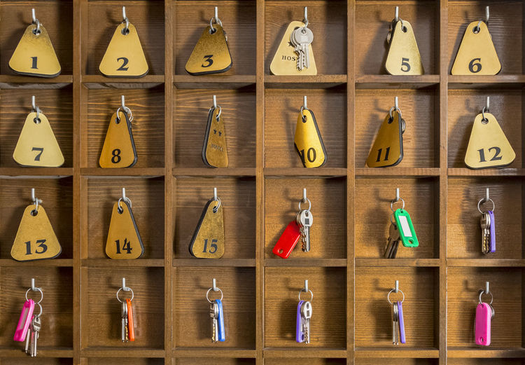 Rooms keys at a two stars hostel reception desk counter. Full Frame Wood - Material Choice Large Group Of Objects Hanging Variation Still Life Indoors  Backgrounds Repetition Arrangement Multi Colored Key Keys Room Keys Keyboard Hotel Hostel Hostel Life Accommodation Cheap Accommodation Guesthouse Inn Travel Tourism