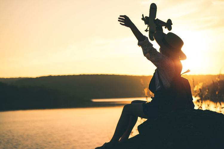 Water Nature Outdoors Landscape Women Travel Backpack Backpacker People Sunlight Sunset Shillouette Sky Orange Color Beauty In Nature Silhouette Tranquility Lifestyles Scenics - Nature Tranquil Scene