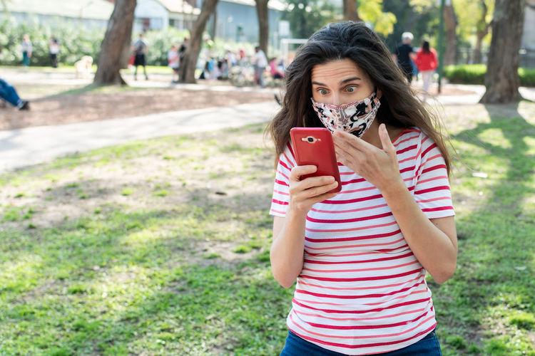 Portrait of teenage girl holding mobile phone