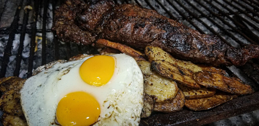 Close-up of breakfast on barbecue grill