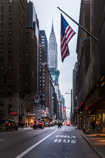 Road amidst buildings in new york city
