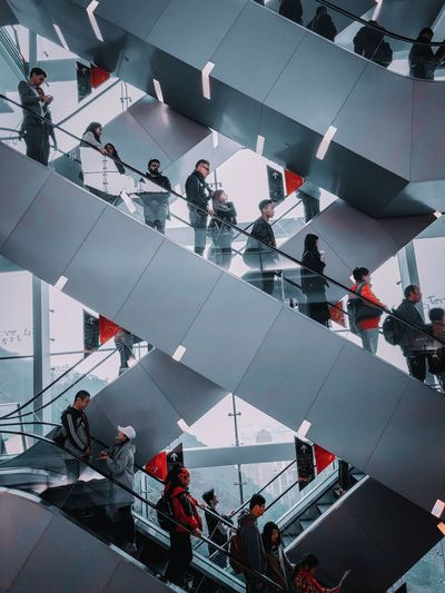 High angle view of people standing on staircase