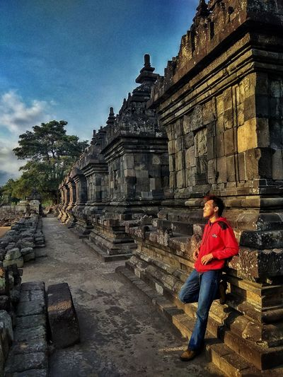 Religion Travel Destinations Tourism Built Structure Architecture One Person Ancient Real People History Full Length Travel Spirituality Old Ruin Ancient Civilization Building Exterior Place Of Worship People Adult Sky Day