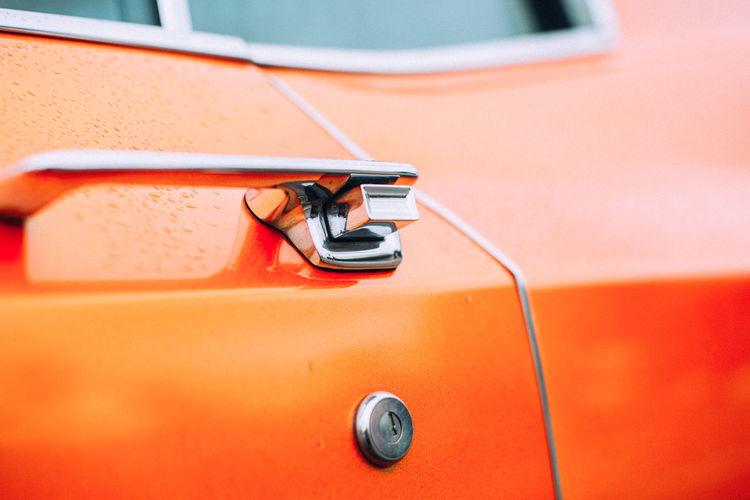 Close-up of orange vintage car