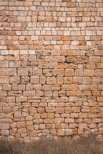 Architecture Brick Built Structure Wall Backgrounds Full Frame No People Brown Textured  Wall - Building Feature Day Brick Wall Pattern Nature Building Exterior Solid Close-up Outdoors Beige Large Group Of Objects Stone Wall