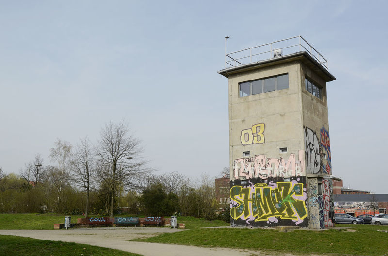 Graffiti on observation tower against clear sky