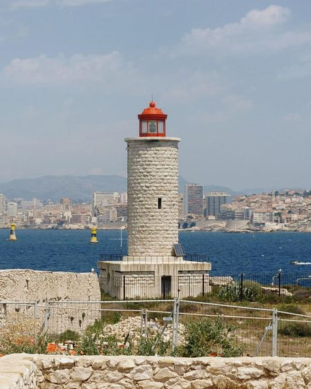 Lighthouse Tower Building Exterior Architecture Travel Destinations Sunlight Tourism Built Structure Travel Sea Sky City Water Day Outdoors Scenics Vacations Cityscape Marseille, France Sea View Eiland EyeEmNewHere