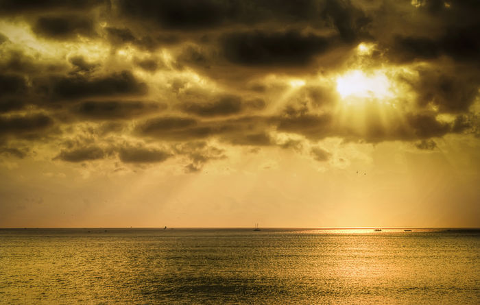 Dark clouds Rays Of Light Clouds Bali, Indonesia Sea Sun Sunset Dramatic Sky Horizon Over Water Water Scenics Nature Sunlight Gold Colored Outdoors
