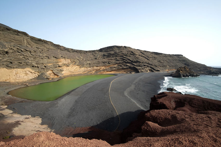 Lanzarote, Spain Green Landscape_Collection Lanzarote SPAIN Beach Beauty In Nature Beauty In Nature Black Lake Landscape Landscape_photography Nature No People Outdoors Rock - Object Scenics Sea Strange Tranquil Scene Tranquility Travel Destinations Volcano Water Wide Angle