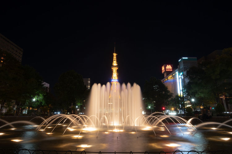 Hokkaido Architecture Building Building Exterior Built Structure Car City City Street Fountain Illuminated Long Exposure Mode Of Transportation Motion Motor Vehicle Nature Night No People Office Building Exterior Outdoors Road Sapporo Street Transportation Travel Travel Destinations