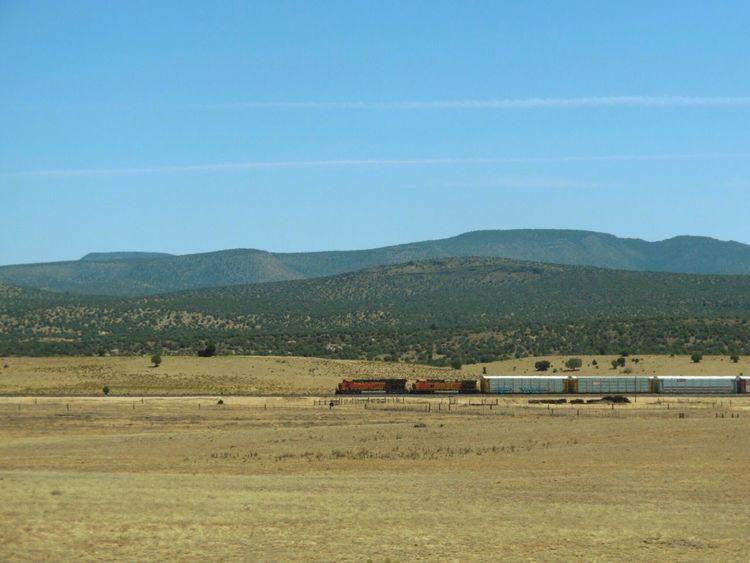 Train Freight Train Mountain Landscape Mountain Range Outdoors Roadtrip Desert America United States Railroad Nowhere Sky Sand From Car Window 砂漠 アメリカ アリゾナ 自然 広大 乾燥 山 景色 青空 山々