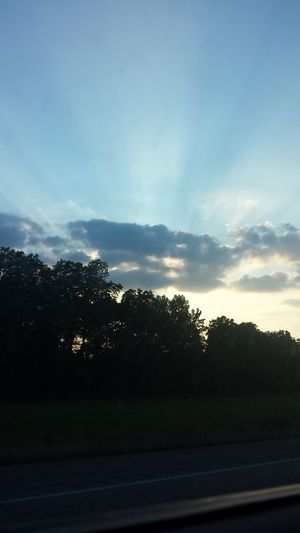 Watching the rays☁☀ Feel The Journey Clouds Nature Sky Sunset Trip Watching The Sunset Passing Trees