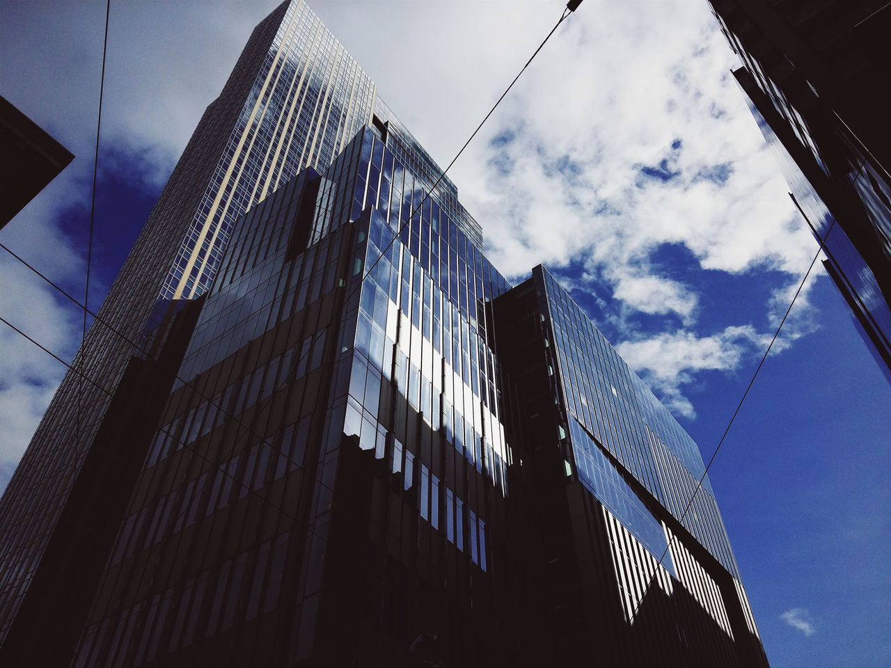 low angle view, architecture, building exterior, modern, built structure, sky, skyscraper, day, outdoors, no people