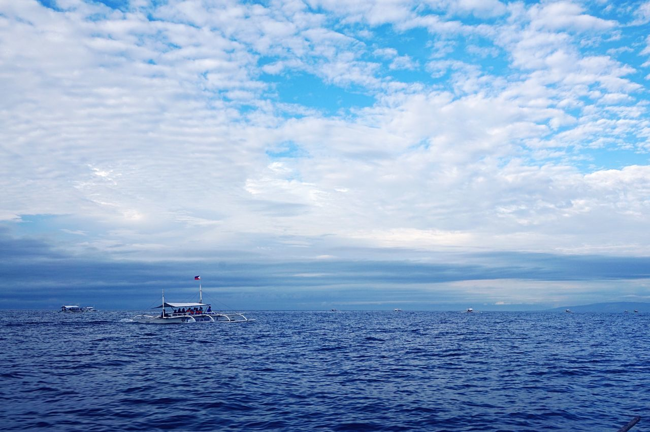 cloud - sky, sea, sky, horizon over water, water, nature, beauty in nature, scenics, nautical vessel, transportation, day, tranquil scene, tranquility, mode of transport, outdoors, waterfront, blue, no people, sailing