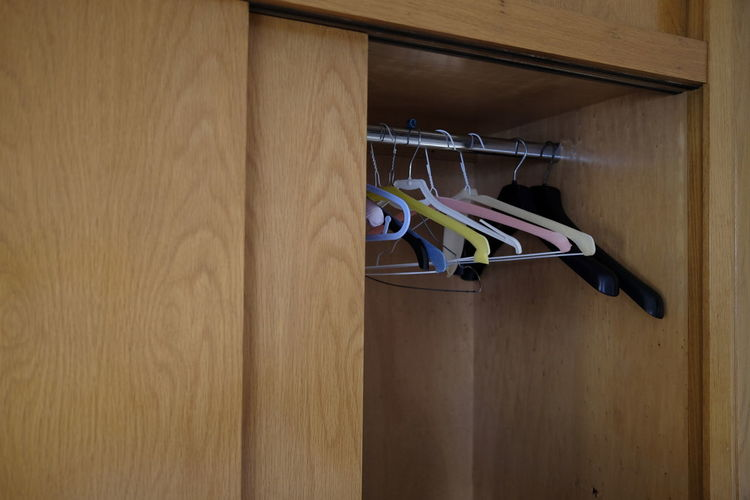 Coathangers hanging in closet