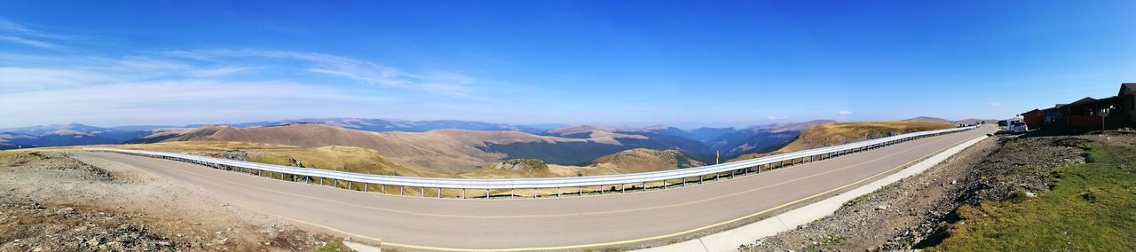 Panoramic View Of Road On Mountain Against Blue Sky