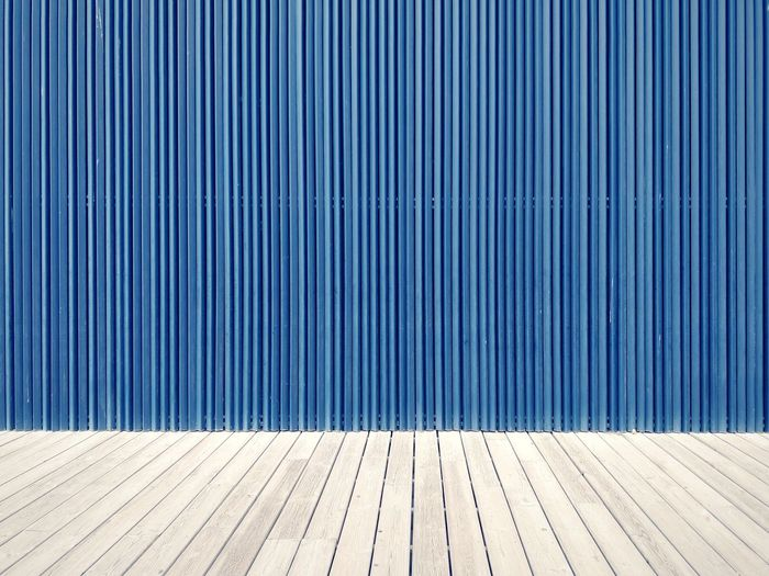 Boardwalk against blue wall