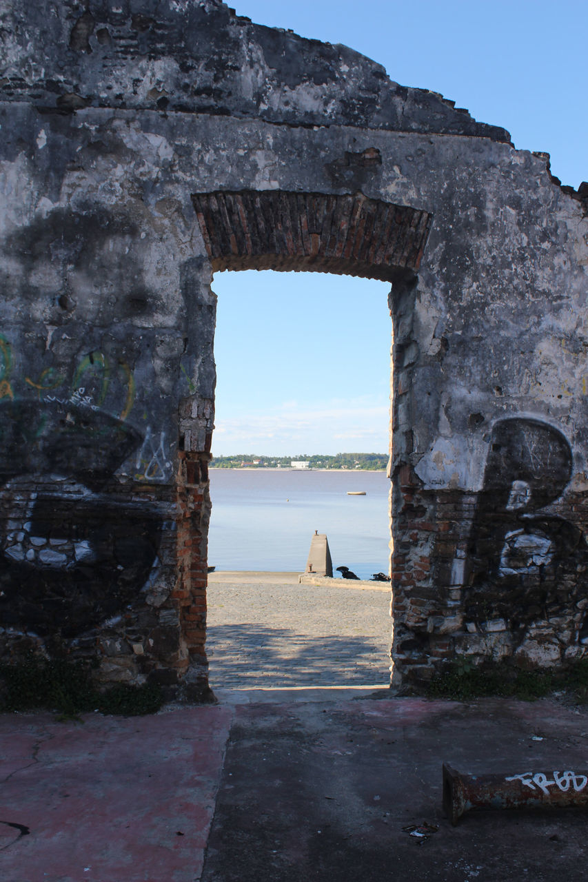 VIEW OF RUINS OF SEA THROUGH ARCH