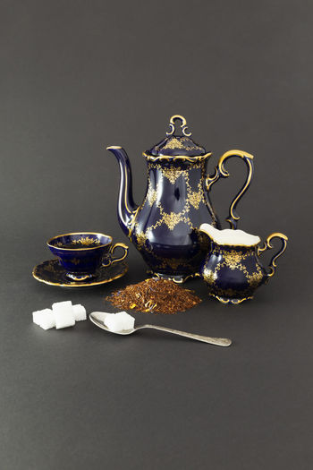 Close-up of tea on table against black background
