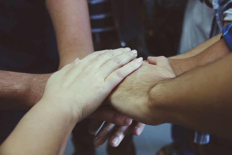 Together hands concept for business teamwork Freelance Life Difference Skin Woman Hand Skin Tone Human Hand Togetherness Human Body Part Bonding Men Connection Love Teamwork Adult People Indoors  Unity Friendship Affectionate Holding Hands Women Close-up Two People Real People Day