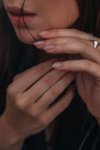 Details of female hands and lips. female beauty