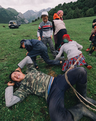 A family team laughs in the face of defeat at the end of a tug-o-war battle with another local family during a Kyrgyz Game. The young children are more competitive than the older family members and was quite entertaining to watch. Community Family Fun Kyrgyzstan Olympus Adult Casual Clothing Day Field Grass Group Of Animals Group Of People Kyrgyz Games Leisure Activity Men Nature Outdoors People Real People Sport Togetherness Tugowar Week On Eyeem Young Men Be Brave A New Perspective On Life