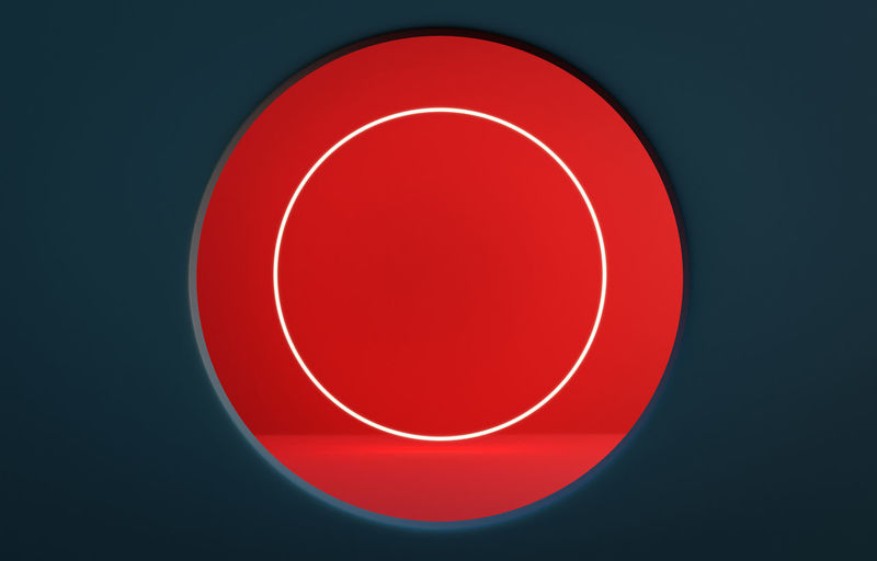 High angle view of illuminated red light against black background