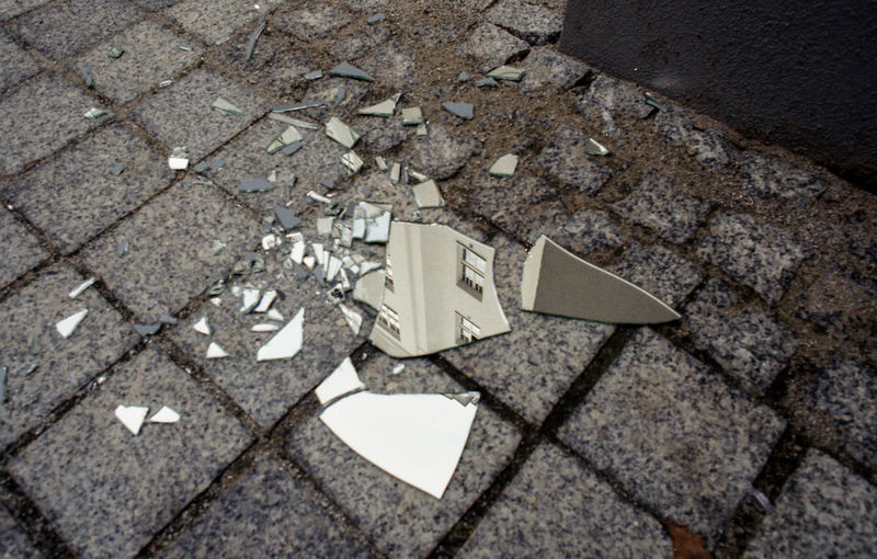High angle view of broken glass on street