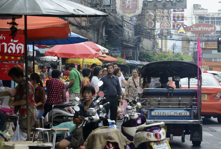 People at market in city