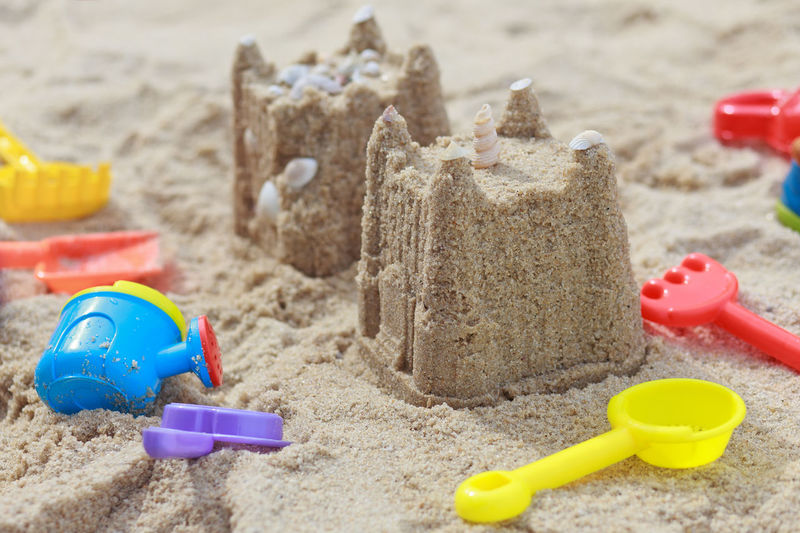 Close-up of sandcastles on beach