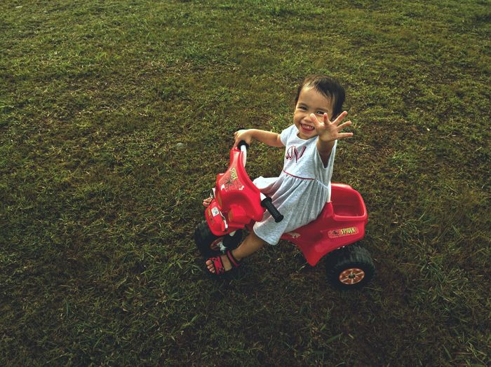 Happy play day Kids Girl One Person Outdoors Outside Bike Grass Potrait Child Childhood Full Length Smiling Boys Red Playing Happiness Males  Grass Soccer Field Autumn Mood EyeEmNewHere